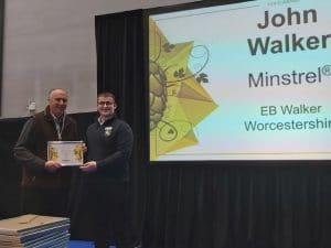 John Walker accepts award from Sam Fizor Customer Service Adviser