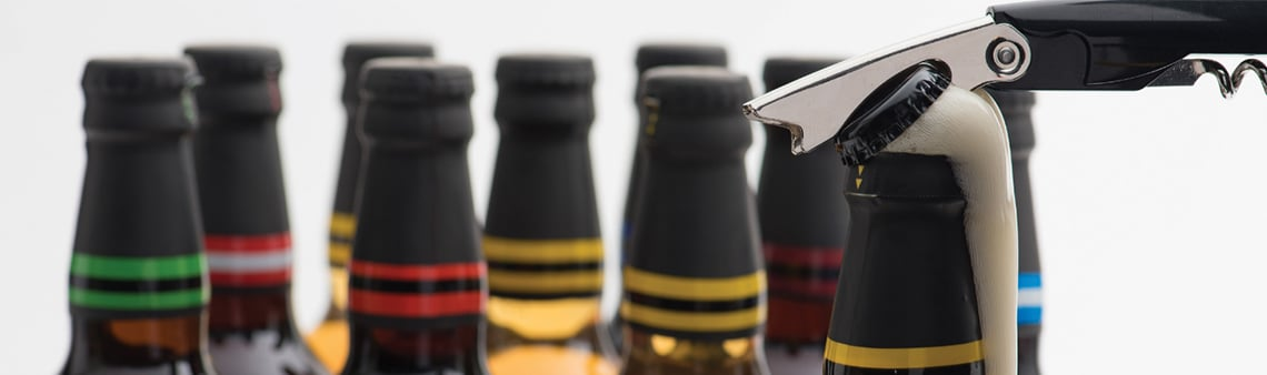 Photo of bottle necks with crown caps on for the Crown and bottle caps page